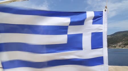 Эгейский : Greece national flag fluttering in the wind