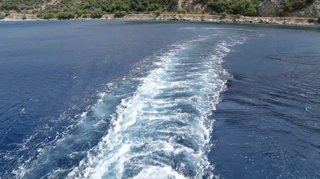 Water trail behind boat