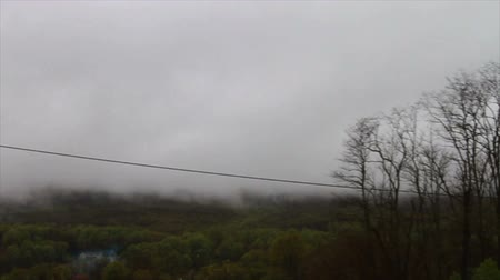 deszcz : 1460 Fog and Clouds Coming down Mountian.mov Wideo