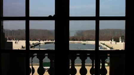 večer : Looking out a Window Palace of Versailles in France