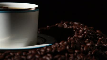 coffee grounds : 1582 Coffee Beans and Coffee Cup.mov Stock Footage