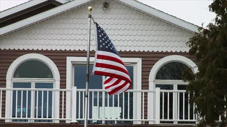 flaga : 1126 American Flag Blowing Next to House and Tree, Slow Motion.mov Wideo