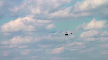 боке : 1182 Helicopter Flying with Blue Sky and Clouds .mov