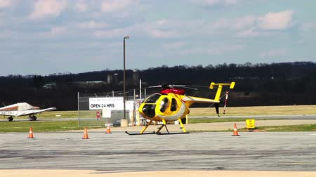 único : Yellow Helicopter at Airport