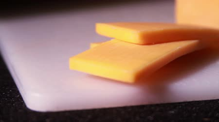 ceramika :  Chedder Cheese Block Being Cut
