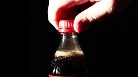 drink cans : Coke Bottle being Open Up