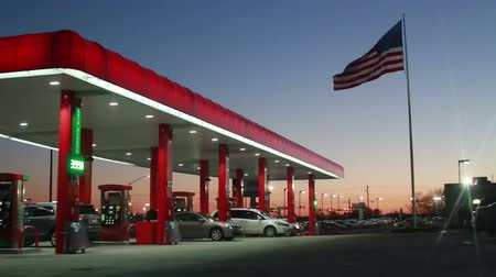 imposto : Gas Station at Sunset with Flag Stock Footage