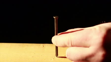 martelo :  Hammering Nail into Wood Stock Footage
