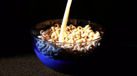 cereais : Cereal Bowl Filling with Milk Vídeos