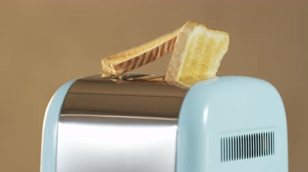 хлеб : Two Loaves of Bread Jumping Out of an Electric Toaster