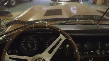 garagem : Dashboard of the Classic Car. Camera Moving Right. Car Ready to Restore Stock Footage