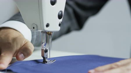 Hands of a Tailor Using a Sewing Machine Stock Footage