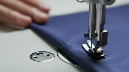 Right Hand of a Tailor Using a Sewing Machine