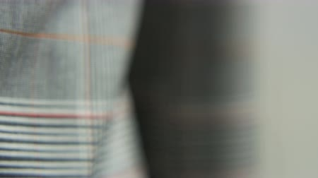 Male Red, White and Jacket. Camera Moving to the Left Stock Footage