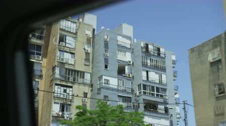View From the Car Moving Among Old Tenement Houses