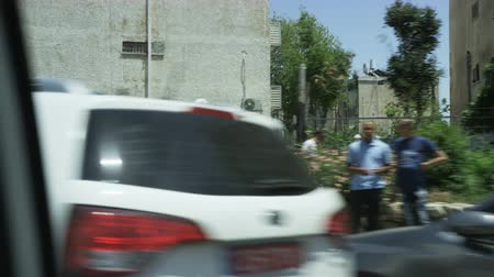 Vehicle Moving Through a Residential Area. Parked Cars Stock Footage