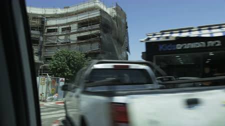 Car Moving Through a Residential Area. Construction Site Stock Footage