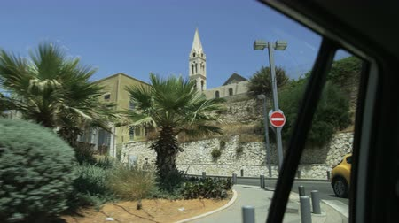izrael : Catholic Church in Tel Aviv Seen From the Riding Car Stock mozgókép
