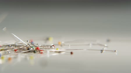 being cut up : Lots of Needles Being Thrown on a Gradient Grey Surface Stock Footage