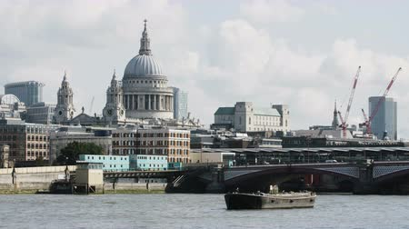 big ben : Boat on the Thames River. St. Pauls Cathedral Behind