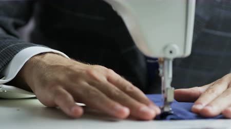 ruhakészítés : Hands of a Tailor Using a Sewing Machine Stock mozgókép