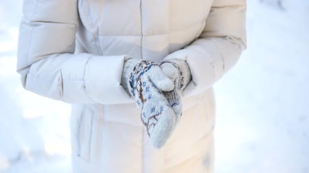 шале : Warming her Cold Hands, Snowy Outdoors. STABILIZED SLOW MOTION SHOT. Girl Rubbing frozen Hands.