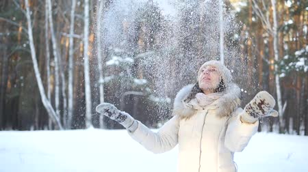 hófúvás : SLOW MOTION: Happy young woman playing with snow