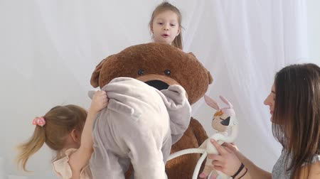 peluş : Happy little girls Plays with Plush Toys in Her Room with parents.