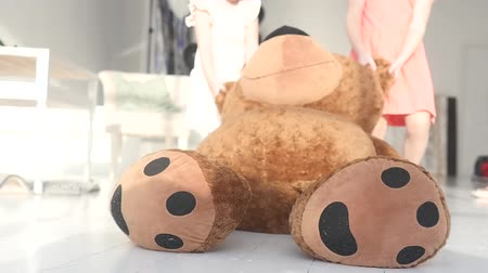 peluş : Happy little girls Plays with Plush Toys in Her Room and drag a big bear on the floor Stok Video