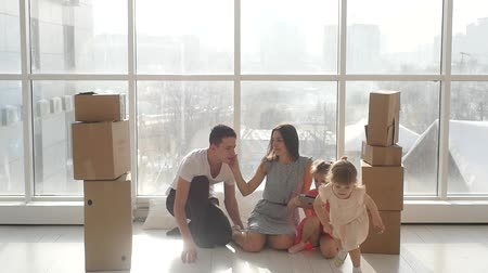 picture box : Happy young family in a new apartment, with children playing in the tablet Stock Footage