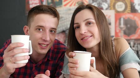 laying : young couple drink coffee in bed, happy smile woman man lovers, love romantic morning slow motion