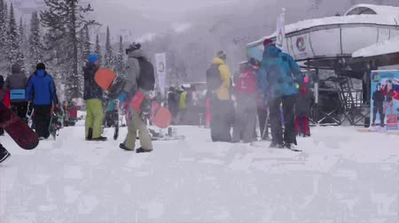 Ski resort Sheregesh, Russia - March 8, 2018. A crowded ski slope, a queue cable car. TimeLapse