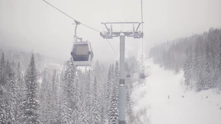 Gondola lift on a background of snowfall