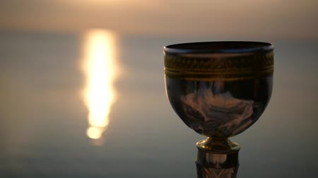 Winner cup against sunset