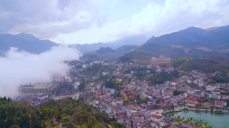 cai : Time lapse scenes movement of fog into the camera, panorama scenes of cityscape SAPA old village from famous landmark Ham Rong, good view point at SAPA, VIETNAM.