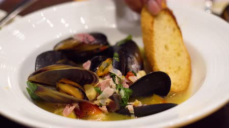 midye : Roasted Black Australia Mussels in white wine sauce. Selective focus, shoot in restaurant, Clean food concept.