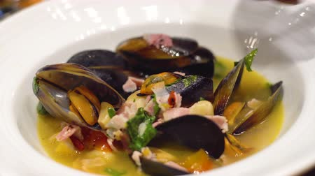 scallop : Roasted Black Australia Mussels in white wine sauce. Selective focus, shoot in restaurant, Clean food concept.