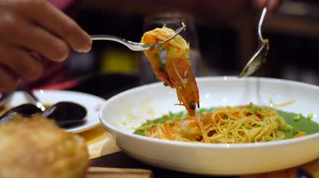 chilli sauce : Spaghetti stir with shrimps and salted egg, basil and dry chilli. Spaghetti dish in restaurant, Selective focus and free space for text. Clean food good taste concept.