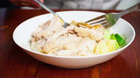 Close up of dish, Steam chicken rice, Sliced hainan-style chicken with marinated rice. Selective focus and free space for text.