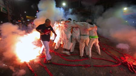ismert : CHONBURI, THAILAND - SEPTEMBER 30, 2019: At night, The parade possessed by his god walking on fire in Vegetarian Festival also known as Nine Emperor Gods Festival.
