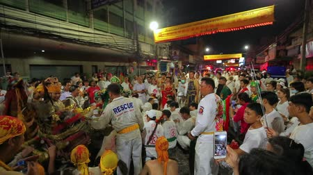imperador : CHONBURI, THAILAND - SEPTEMBER 30, 2019: At night, The parade possessed by his god walking on fire in Vegetarian Festival also known as Nine Emperor Gods Festival.