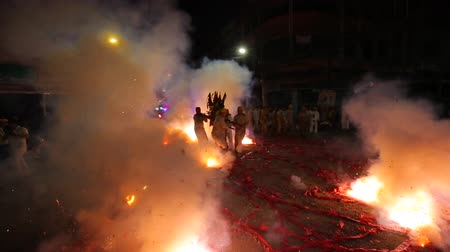devět : CHONBURI, THAILAND - SEPTEMBER 30, 2019: At night, The parade possessed by his god walking on fire in Vegetarian Festival also known as Nine Emperor Gods Festival.