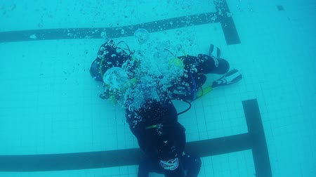 compressed : Chonburi, Thailand -September 20,2019: Child doing a scuba diving course. Child learning scuba diving in the pool. Successes of children of learning. Bubble of scuba diving.