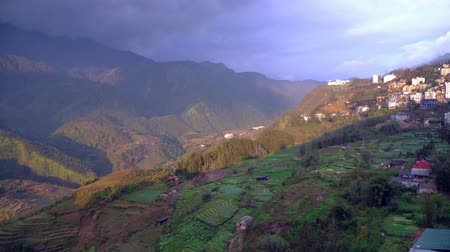 cai : Camera movements shot of panorama scenes of cityscape SAPA old village from famous landmark Ham Rong, good view point at SAPA, VIETNAM. Stock Footage