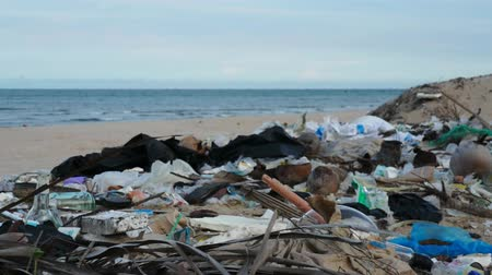plastics : Pollution on the beach of a tropical island. Environmental destruction. Stock Footage