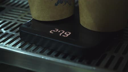 temper : Coffee cups On Electronic Scales Stock Footage