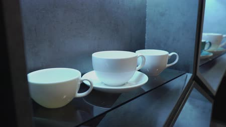 латте : White porcelain coffee cup in a cafe or in the kitchen