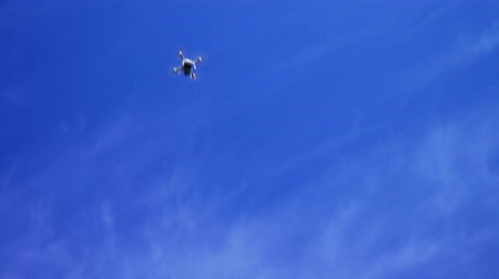 Dron, quadrocopter flying away to the sun Stock Footage
