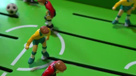piłkarz : Table football, childrens board game, slow motion