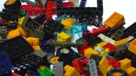 Colorful plastic designer at the table, building kit, slow motion Stock Footage